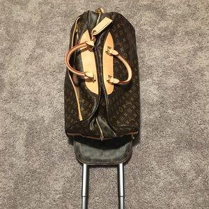 Louis Vuitton luggage; dustbag, lock & key.